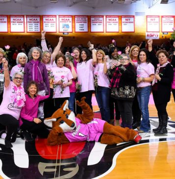 At halftime, Marist Athletics continued its annual halftime survivor salute, with over 20 breast cancer survivors receiving recognition for their courage.