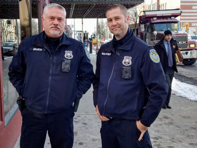 Community Policing Officers Mike Braren and Kevin Van Wagner, PBA President, with the new body cams visible just below their badges.