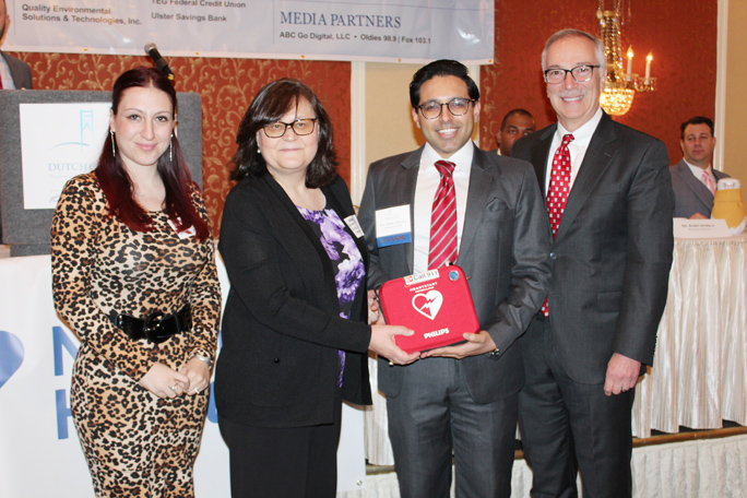 Nina Schutzman, development coordinator, and Branka Bryan, executive director for the shelter, are presented an AED in honor of Heart Month from Tim Massie, senior vice president of marketing, public affairs and government relations for Nuvance Health and cardiologist Dr. Sunny Intwala from The Heart Center.