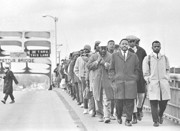"John Lewis and marchers in the documentary ""John Lewis Good Trouble""."