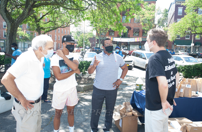 NYS Senator James Skoufis (far right) and NYS Assemblyman Jonathan Jacobson (far left) handed out free masks and sanitizer on Sunday, July 26, 2020 while speaking with Armani and Torrance Harvey. Hudson Valley Press/CHUCK STEWART, JR.