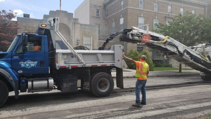 City of Newburgh Public Works staff mill a section of Grand Street on Monday, July 13 as part of the City's 5-year paving plan that will improve more than 25 miles of roadway throughout the City.