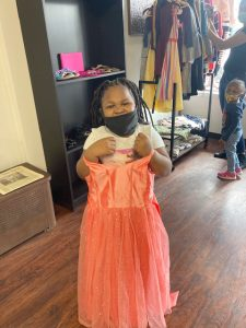 Amaris Murphy, age 5, proudly shows off the dress she selected as part of her back-to-school wardrobe at the August 30 Black Collective 845 event, involving eight Newburgh area businesses showing their gratitude for Newburgh youth as they diligently continue their studies during these challenging times.