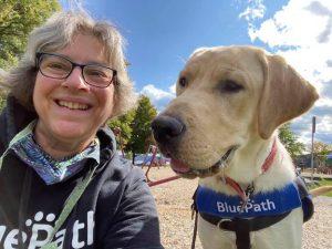 Puppy raiser Anne Garretson with future service dog Radio at BluePath Service Dog's fourth annual walkathon.