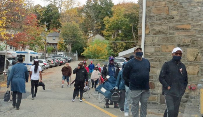 An estimated 500 people lined up around the entire city block by the Middletown Senior Center long before the polls opened at noon on Saturday.