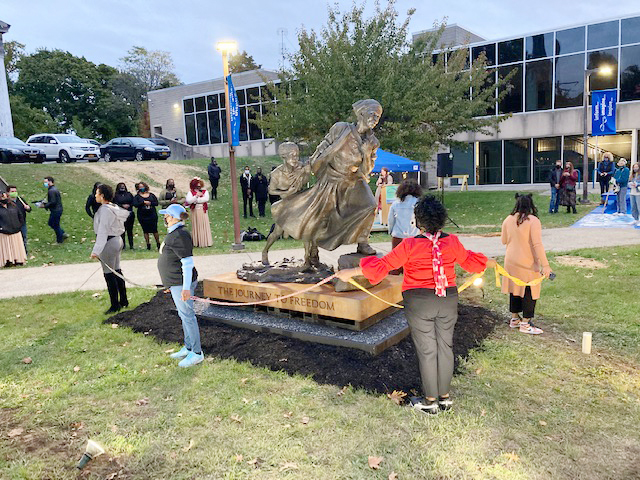 """""""Journey to Freedom"""" traveling sculpture project of iconic legend Harriet Tubman is officially installed Monday evening in the Courtyard at the Newburgh Free Library. The awesome nine foot structure is intended to serve as an uplifting symbol of Liberation, Legacy and Truth, for all to be inspired by who view it."""