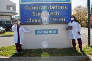 Surgical technology graduates Courtney Balding, (Left) of Milton and Khari Wellman, (Right) of Poughkeepsie, pose happily in front of the Ulster BOCES Adult Career Center on Saturday, November 7.