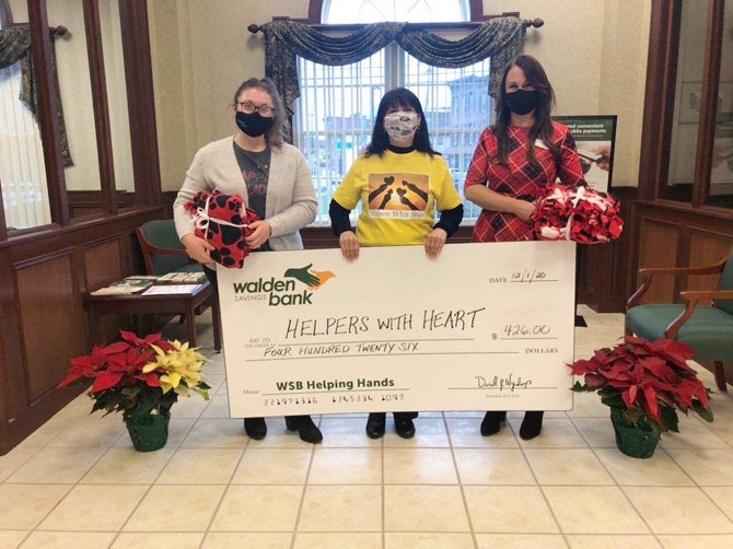 Walden Savings Bank team members present monetary donation to Helpers with Heart. (from left to right) Jenna Frey, Walden Savings Bank Branch Manager, Walden Branch; Roxanne Volpe, Founder, Helpers With Heart; and Susan Wareka, Walden Savings Bank Assistant Branch Manager, Walden Branch.