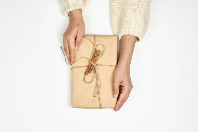 Wrapping gifts in brown grocery bags or parcel paper makes use of an everyday item that you may already have in your home while keeping your wrapping recyclable. Photo: Marco Verch, FlickrCC.