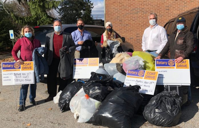 Rhinebeck Savings Bank in Goshen served as a collection point for donations to Goshen Rotary Club's winter coat drive. Michael Peters (l), Resource Exchange Coordinator for Catholic Charities of Orange, Sullivan, and Ulster, accepted the donation of coats from Goshen Rotary Club member Amy Van Amburgh (c) and Club President Mark Gargiulo.