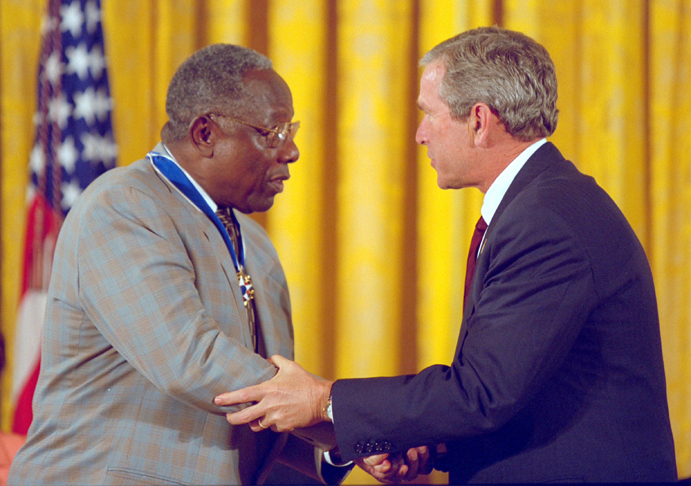 President George W. Bush presents the Presidential Medal of Freedom to baseball legend Henry Aaron during a ceremony at the White House, July 9, 2002.