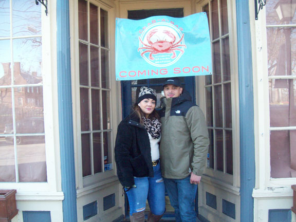 """Ronnie and Tiffany Maisonet stand outside their new business location on 85 Liberty Street in the City of Newburgh which they are in the process of renovating and will bear the name, """"Crab a Bag,"""" offering authentic Spanish Seafood. The couple is extremely excited to bring this missing type of cuisine to the rapidly growing Liberty locale."""