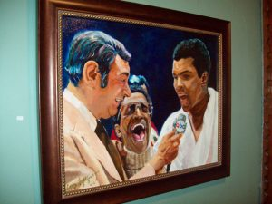 This very realistic image of legendary boxer, Muhammed Ali with sports announcer Howard Cosell and musician Sammy Davis Jr. is one of over 80 pieces on display at the Howland Cultural Center this month in a group exhibit, celebrating Black History Month. Its artist, Corey Lightfoot, contributed eight other pieces; while the show itself includes 13 artists and features works of painting, photography and illustrated children's books.