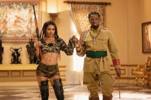 General Izzi (Wesley Snipes) presents his daughter Bopoto Izzi (Teyana Taylor) to the King.
