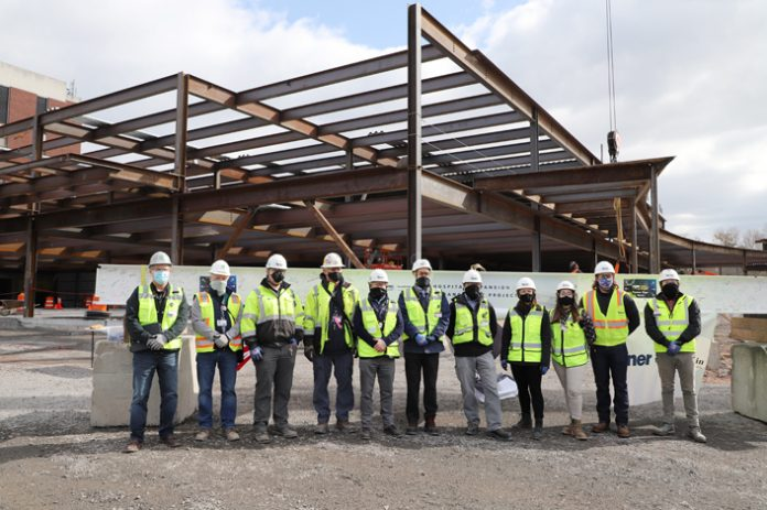 Construction workers placed the final steel beam atop the $92.9 million, 127,000-square-foot expansion and enhancement of WMCHealth's HealthAlliance Hospital: Mary's Avenue Campus in a topping-off ceremony.