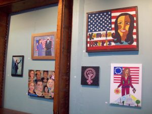 Some of the many pieces of artwork covering the Howland Cultural Center's front wall, containing a tribute to Vice President, Kamala Harris, celebrating Women's History Month. The over 30 women group art show, now in its 27th year, will be open to the public each Saturday and Sunday, from 1-5, throughout the month of March.