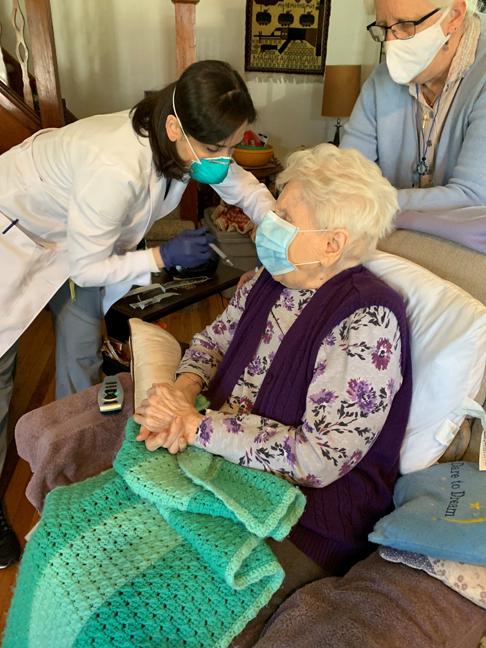 Orange County Health Commissioner Dr. Irina Gelman vaccinates Sophia Bott at her Greenwood Lake home on Sunday, March 21st. Seated behind Bott is one of her caregivers, Karen Eskholme.