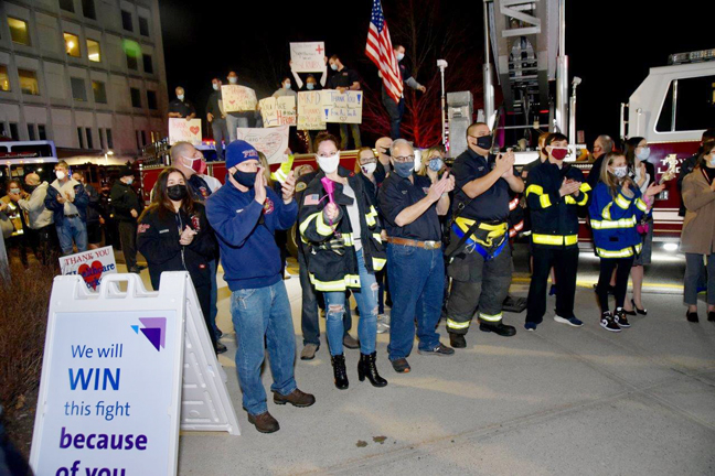Mount Kisco Firefighters, patient families and visitors applaud Northern Westchester Hospital's healthcare heroes as they change shifts on the year anniversary of first COVID-19 positive patient admission.