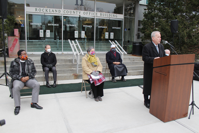 Rockland County Executive Ed Day offers remarks during a candlelight memorial in honor of those lives lost to COVID.