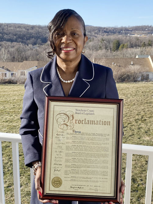 Dr. Angela White with proclamation.