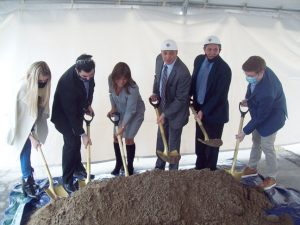 Administrative staff as well as their family members and some business partners of the President Container Group officially break ground in a special ceremony, celebrating the $40 million expansion of its supercenter which will create 50 new jobs when completed.
