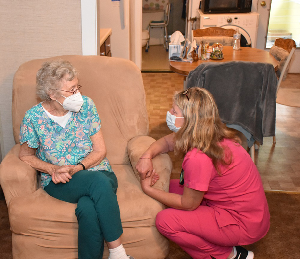 Helen Klinger, left, chats with RN Sue Flynn before receiving her COVID-19 vaccine at her Woodbourne home, courtesy of Sullivan County Public Health Services' homebound vaccination program.