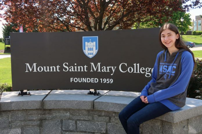 Kimberly Kelly of Wantagh, N.Y., who graduated from Mount Saint Mary College in May, will begin taking courses in publishing at New York University in the fall. Photo: Matt Frey