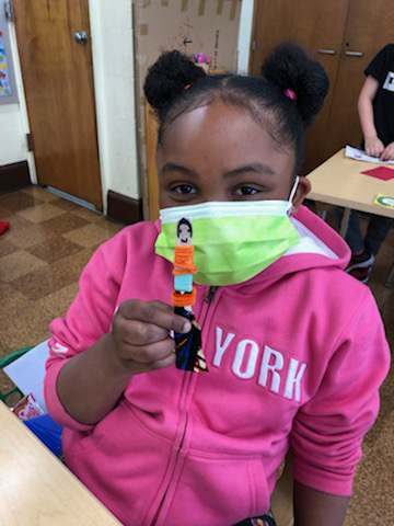 Student at JFK school with her worry doll in April, 2021. Photo: Reher Center