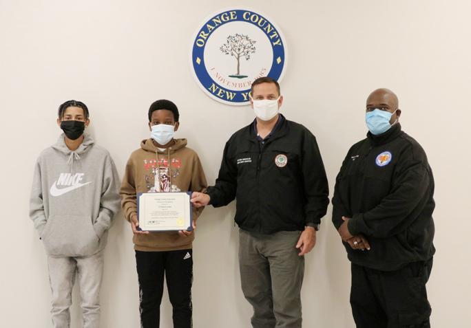 (From left to right) Jayden Mercado, Ty'Shawn James, Orange County Executive Steven M. Neuhaus and Orange County 911 dispatcher Stewart Matthew.