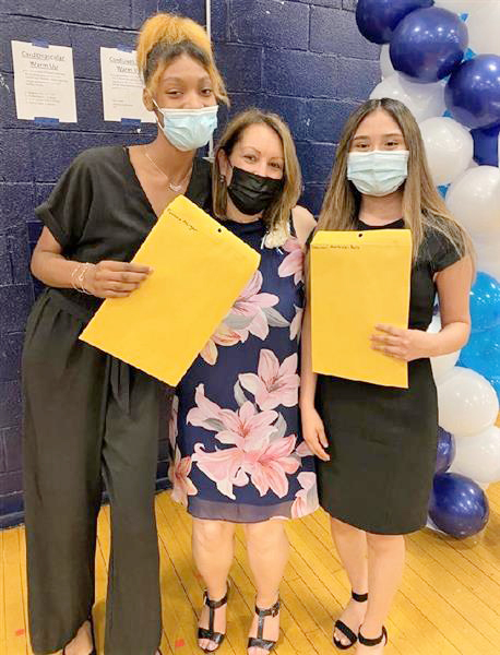 At left, students Tyonna Morgan and Dayaneri Martinez-Ruiz pose for a photo with Principal Kelleyann Royce-Giron (center) after the awards night. Morgan received a Universal Medical Resource scholarship of $750. Martinez-Ruiz received scholarships totaling $5,250 and earned an Honor Graduate award.