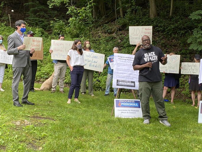 The Progress 4 Peekskill Democrats for Mayor and Council gathered with residents, advocates and supporters to bring attention to Peekskill's housing affordability crisis and discuss steps they will take in response if elected to office. Picture above Steven Dillard.