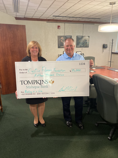 Tompkins Mahopac Bank President and CEO Jerry Klein (right) met up with the bank's Vice President and Aircraft Lending Manager Lisa McPartland (left).