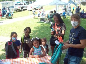 Youth at Saturday's Community Appreciation Day, held at the City of Newburgh's Downing Park, have fun as they receive their free, personalized book bags to start the new school year. In addition to the book bags and other school supplies, there was a host of free food, entertainment as well as offerings from over 26 vendors.