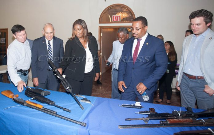 NY Attorney General Letitia James examines a gun turned in during a gun buyback event in Newburgh on Thursday, July 22, 2021 with Adam Chen, NYS Assemblyman Jonathan Jacobson, Councilman Anthony Grice, Mayor Torrance Harvey and NYS Senator James Skoufis. HUDSON VALLEY PRESS/ Chuck Stewart, Jr.