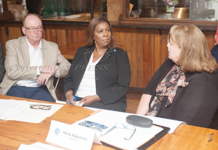 NY Attorney General Letitia James, center, listens to Sheila Kilpatrick of RUPCO, right, during a housing roundtable in Poughkeepsie on Thursday, July 22, 2021, as Mayor Rob Rolison, left looks on. HUDSON VALLEY PRESS/ Chuck Stewart, Jr.