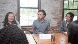 Eli Berkowitz of Community Voices Heard discusses housing issues with NY Attorney General Letitia James during a roundtable in Poughkeepsie on Thursday, July 22, 2021. HUDSON VALLEY PRESS/ Chuck Stewart, Jr.