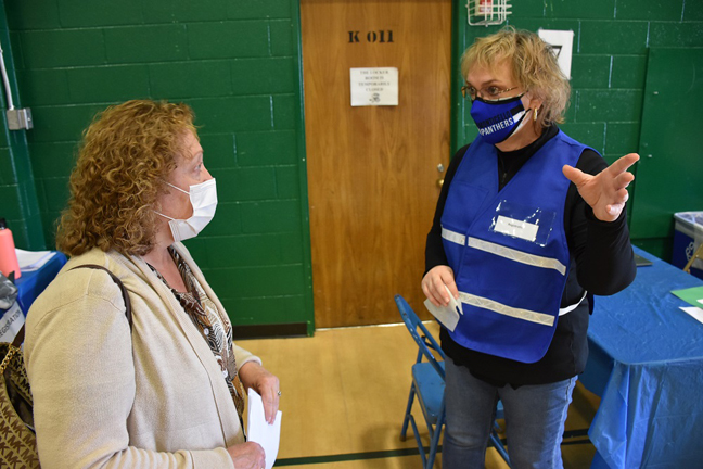 District 2 Legislator Nadia Rajsz, left, listens to volunteer Lori Orestano James explain the registration process for people receiving the COVID-19 vaccine at a recent clinic at SUNY Sullivan.