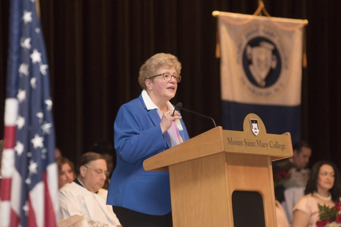Christine Berté recently took the helm as the Dean of the School of Nursing at Mount Saint Mary College. She is seen here honoring graduating Nurse Practitioners during the college's White Coat Ceremony on May, 11, 2018 in Aquinas Theatre. Photo Credit: Lee Ferris