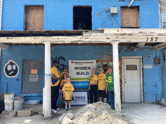 """Walkers from Sundays Annual Habitat for Humanity of Greater Newburgh's Annual Walk for Housing stand in front of one of the several homes they passed during their 2.8 mile trek. This one is currently under renovation, being built by the Women's Build section of the Habitat organization that offers a """"hands-up""""in home ownership."""