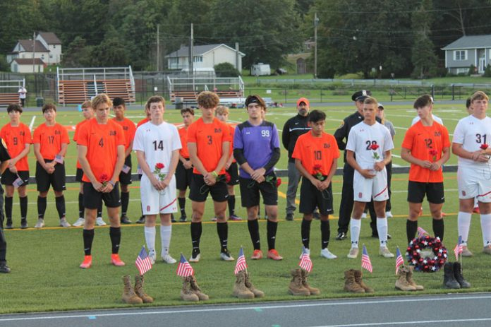 Varsity soccer players from Marlboro and Onteora participated in a ceremony honoring the 13 soldiers who were killed in the Kabul airport attack in Afghanistan during a special 9/11 memorial soccer game held at Marlboro High School.