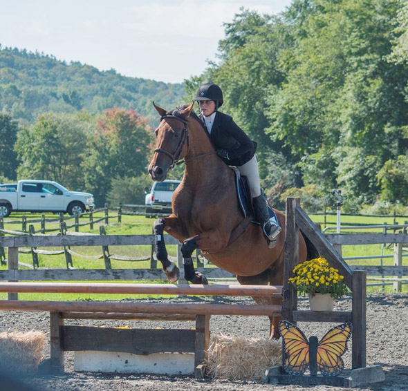 The SUNY New Paltz equestrian team kicked off its 2021-22 season Saturday at home in a National Collegiate Equestrian Association (NCEA) competition against Lynchburg. Devyn Looney came away with the win on Clyde. Photo: Brooke Vissicchio