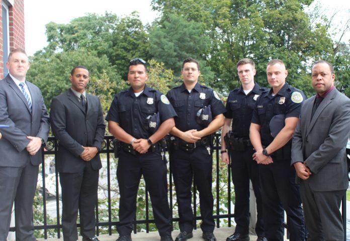 From left are new City of Poughkeepsie Police Officers Gary Beahan, Se'quan Heard, Hamilton Nunez, Nicholas Paradies, John Sullivan, Anthony Tarantino, and Christopher Warrick.