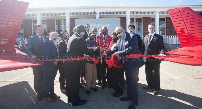 Tuskegee Airmen Enoch Woodhouse, center, helps cut the ribbon for The RedTail Flight Academy at New York Stewart International Airport on September 10, 2021. HUDSON VALLEY PRESS/ Chuck Stewart, Jr.