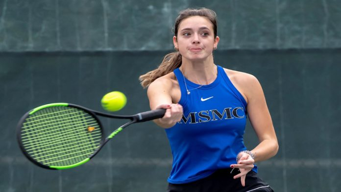 Carly Green remains unbeaten in singles play for the Knights.